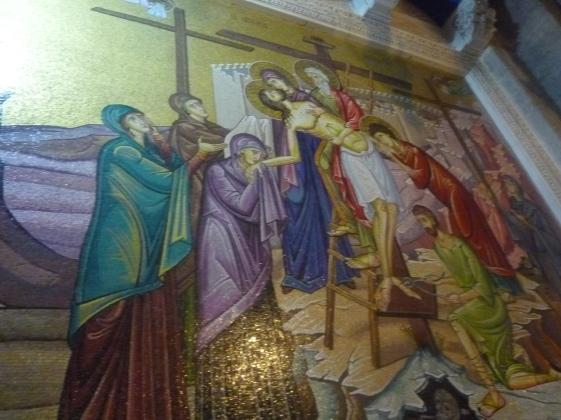 聖墓教堂的馬賽克畫描繪了耶穌訂十字架的情景