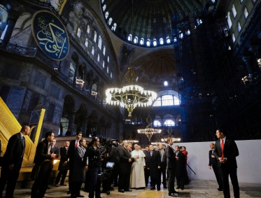Pope Francis visits Haghia Sofia, the Byzantine church-turned-mosque that is now a museum, in Istanbul, Saturday, Nov. 29, 2014. His head bowed and hands clasped in front of him, Pope Francis on Saturday stood in two minutes of silent prayer facing east inside one Istanbul's most important religious sites, as he shifted gears toward more religious affairs on the second leg of his three-day visit to the mainly Muslim nation. (AP Photo/Gregorio Borgia)